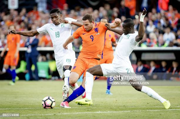 Netherlands' Vincent Janssen vies with Simon Deli and Eric Bailly of Ivory Coast during a football match between The Netherlands and Ivory Coast in...
