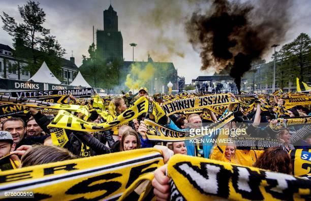 Netherland's Vitesse Arnhem supporters celebrate during the ceremony of Vitesse Arnhem's selection in front of City Hall of Arnhem on May 1 after...