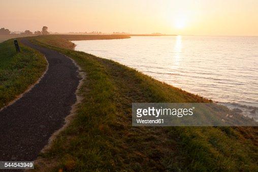 Netherlands, Waterland, sunrise above the Ijsselmeer