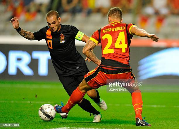 Netherlands' Wesley Sneijder and Belgium's Toby Alderweireld vie for the ball during their friendly football match in Brussels on August 15 2012 AFP...