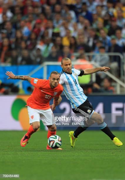 Netherlands' Wesley Sneijder battles for the ball with Argentina's Javier Mascherano