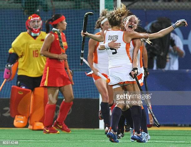 Netherland's Wieke Dijkstra and goal scorer Maartje Goderie celebrate after winning their women's field hockey final China of the 2008 Beijing...