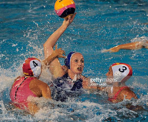 Netherlands' Yasemin Smit is held back by Spain's Roser Tarrago and Anna Aspar during their preliminary round match of the women's water polo...