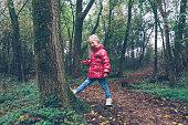 Netherlands, Zeeland, Ritthem, Girl (2-3) pushing tree
