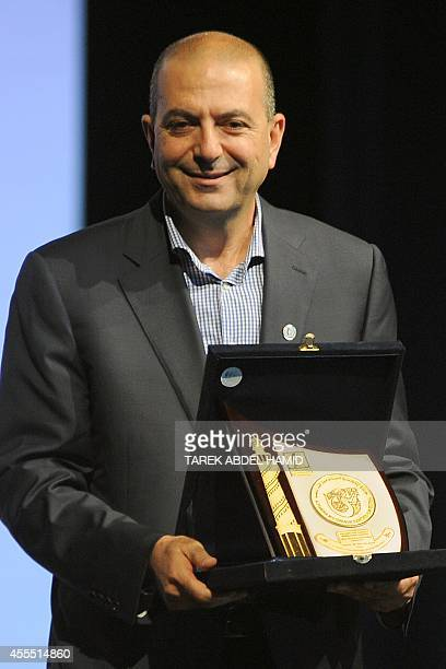 Netherlandsbased Palestinian director Hani Abu Assaad director of 'Omar' is honoured at the 30th Alexandria film festival closing session on...
