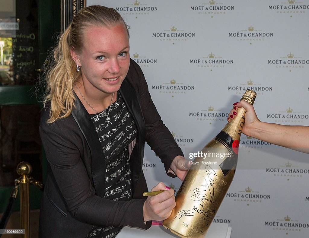 Netherlands`s <a gi-track='captionPersonalityLinkClicked' href=/galleries/search?phrase=Kiki+Bertens&family=editorial&specificpeople=7945371 ng-click='$event.stopPropagation()'>Kiki Bertens</a> signs a bottle of champagne at the ASB Classic Player's Party at TriBeCa on January 3, 2015 in Auckland, New Zealand.