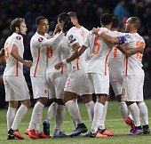 Netherlands's players celebrate their goal during the Euro 2016 qualifying football match between Kazakhstan and Netherlands in Astana on October 10...