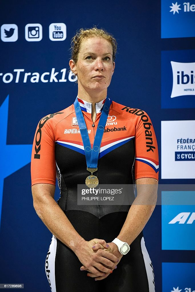 Netherlands's silver medalist Kirsten Wild poses on the podium of the women's Omnium race at the European Track Championships in Saint-Quentin-en-Yvelines on October 22, 2016. / AFP / PHILIPPE
