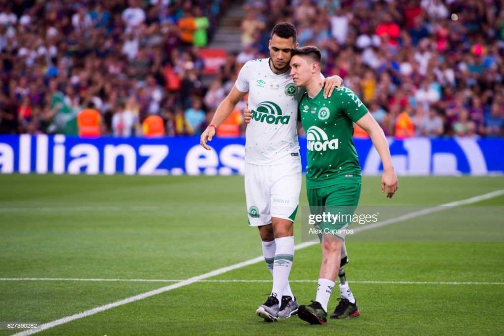 Neto (L) and Follmann (R) of Chapecoense react after making the kick-off before the Joan Gamper Trophy match between FC Barcelona and Chapecoense at Camp Nou stadium on August 7, 2017 in Barcelona, Spain.
