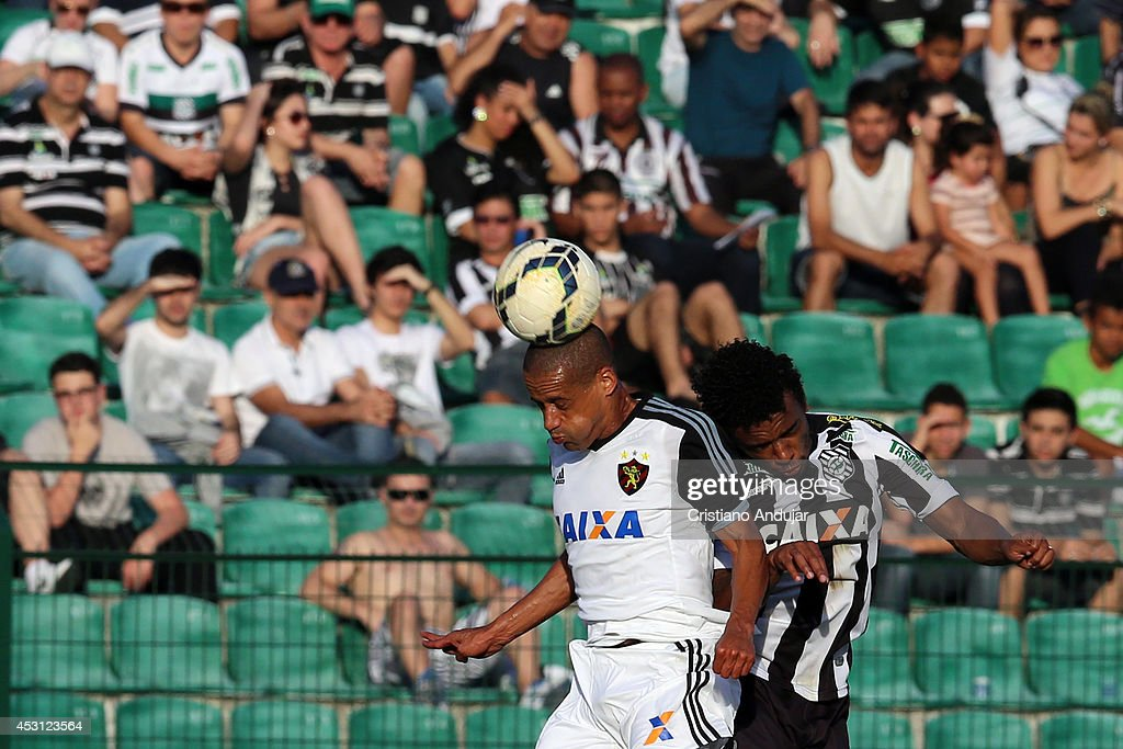 Neto Baiano #11 of Sport wins header with Paulo Roberto #5 of Figueirense during a match between Figueirense and Sport as part of Campeonato Brasileiro 2014 at Orlando Scarpelli Stadium on August 3, 2014 in Florianopolis, Brazil