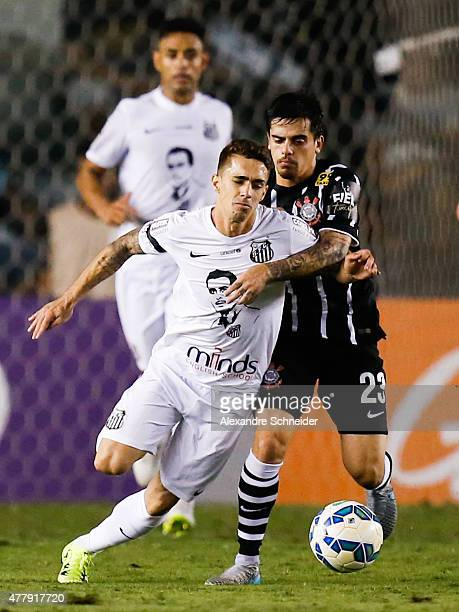 Neto Berola of Santos and Fagner of Corinthians in action during the match between Santos and Corinthians for the Brazilian Series A 2015 at Vila...