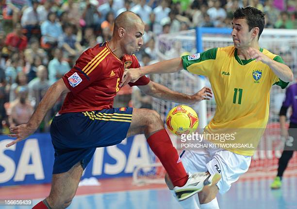 Neto of Brazil battles for the ball with Fernandao of Spain on the way to Brazil winning the final match of the FIFA Futsal World Cup 2012 in Bangkok...