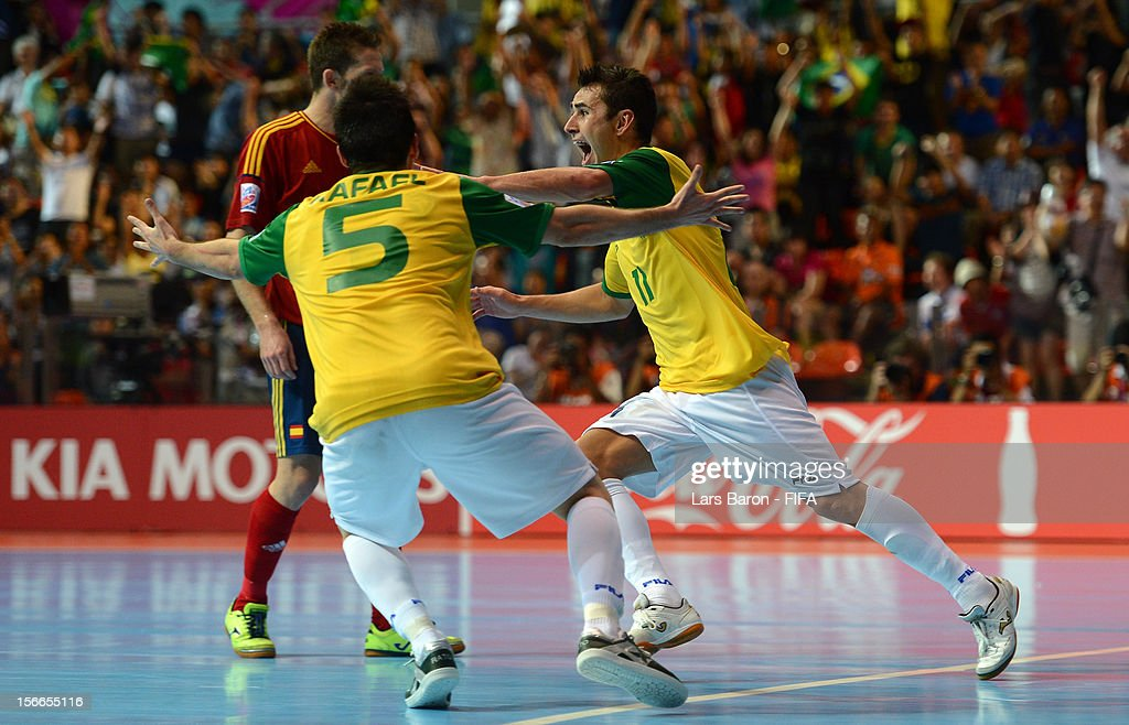 Neto of Brazil celebrates after scoring his teams winning goal during the FIFA Futsal World Cup Final at Indoor Stadium Huamark on November 18 2012...