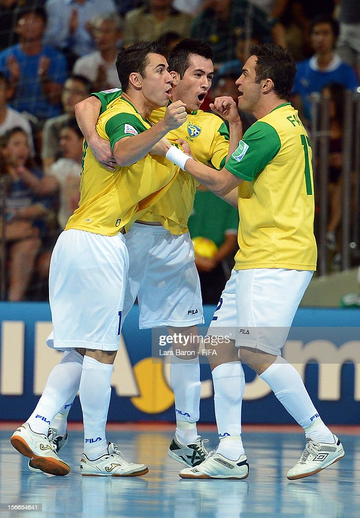 Neto of Brazil celebrates with team mates Franklin and Falcao after scoring his teams first goal during the FIFA Futsal World Cup Final at Indoor...