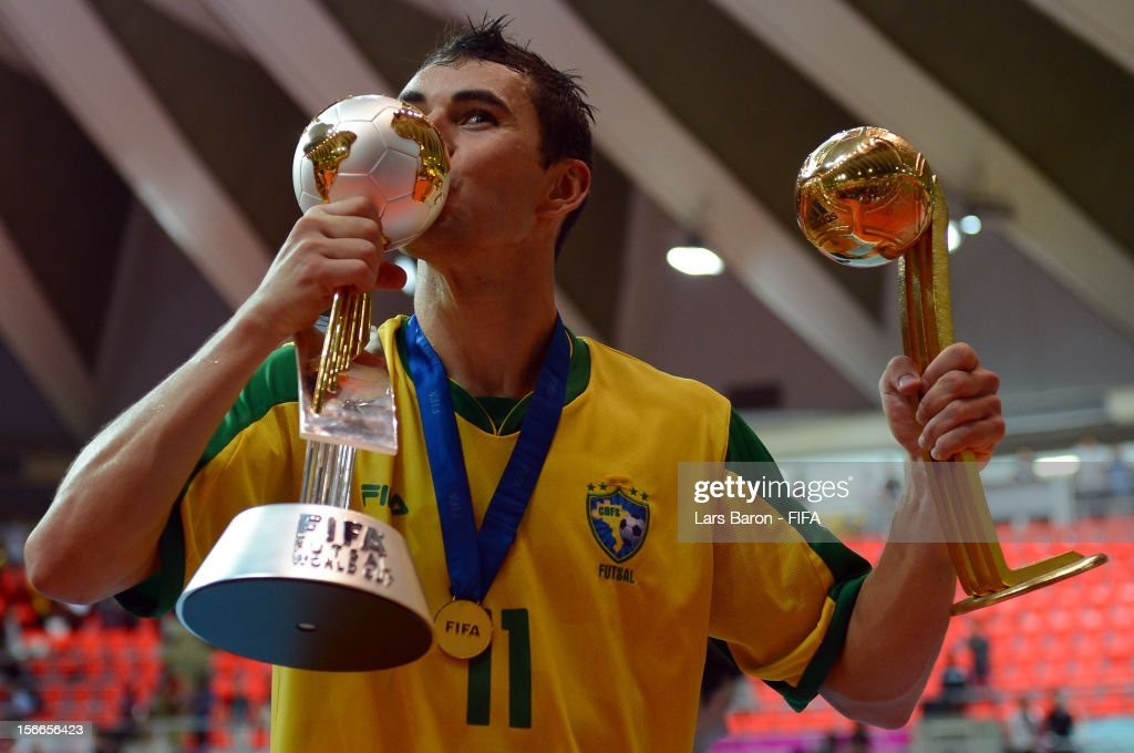 Neto of Brazil kisses the trophy after winning the FIFA Futsal World Cup Final at Indoor Stadium Huamark on November 18 2012 in Bangkok Thailand