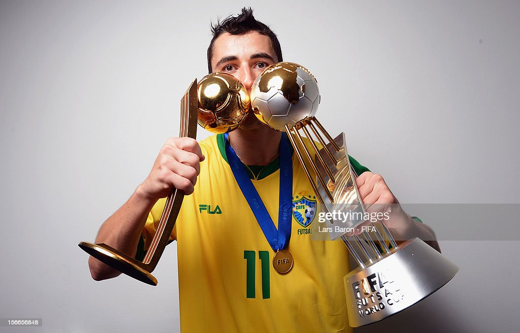 Neto of Brazil poses with the trophies in the locker room after winning the FIFA Futsal World Cup Final at Indoor Stadium Huamark on November 18 2012...