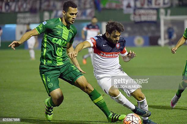 Neto of Brazil's Chapecoense vies for the ball with Ezequiel Cerutti of Argentina's San Lorenzo during their 2016 Copa Sudamericana semifinal second...