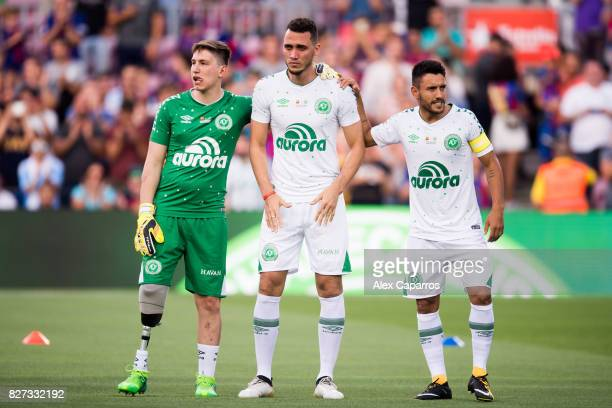 Neto of Chapecoense cries between his teammates Follmann and Alan Ruschel before the Joan Gamper Trophy match between FC Barcelona and Chapecoense at...