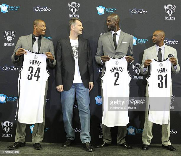 Nets majority owner Mikhail Prokhorov joins Kevin Garnett Paul Pierce and Jason Terry of the Brooklyn Nets during a press conference at the Barclays...