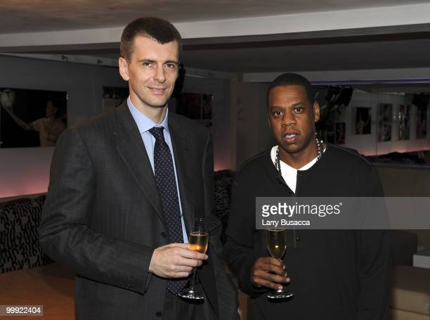 Nets owner Mikhail Prokhorov with cultural icon and Nets investor JAYZ celebrate Prokhorov's purchase of the team at lunch today at JAYZ's 40/40 club...