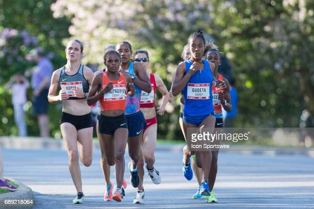 Netsanet Gudeta of Ethiopia quietly pulls to the front of the women's lead pack and sets up her victory over Paskalia Chepkorir of Kenya in the...