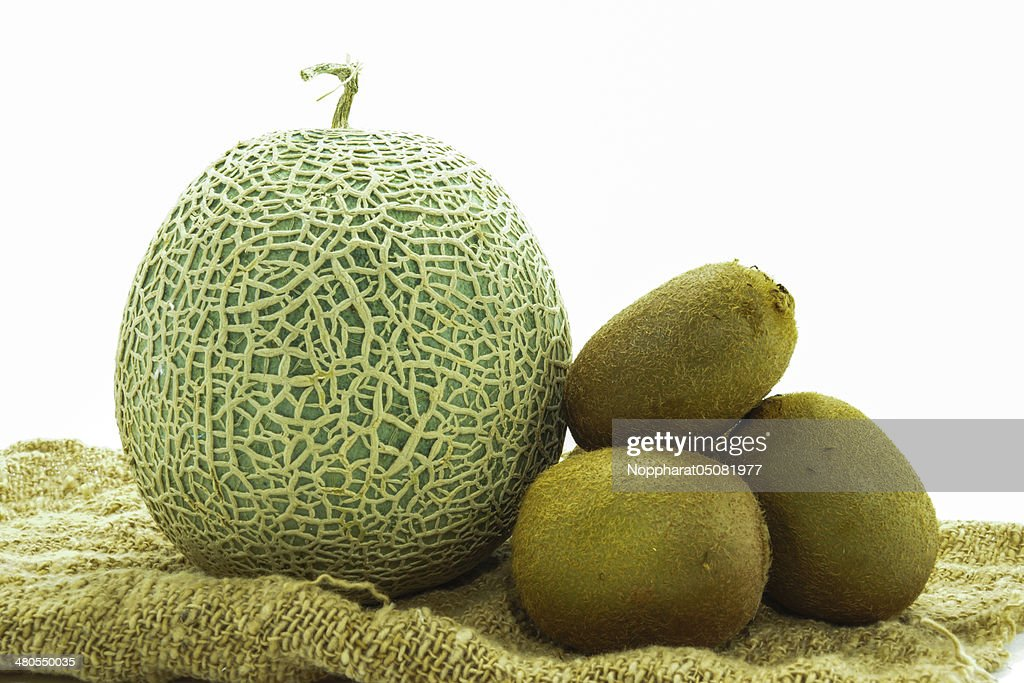 Netted melon and kiwi on white background : Stock Photo
