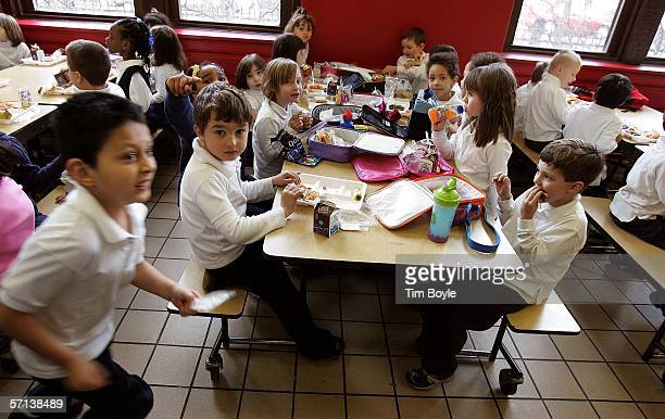 Nettelhorst Elementary School students eat their lunches March 20 2006 in Chicago Illinois US Senator Dick Durbin stopped by the school to visit the...