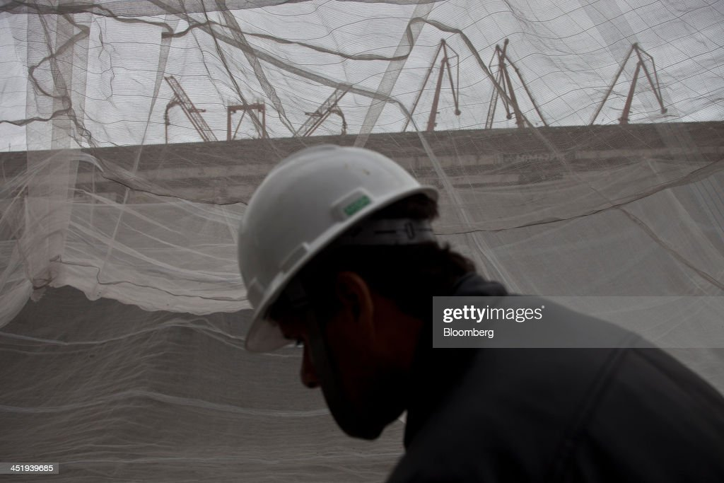 Netting is hung on the site of the demolition of a 5 km-long stretch of highway to make way for the revitalization of the port area in Rio de Janeiro, Brazil, on Saturday, Nov. 23, 2013. The government will auction three highways before year-end, Finance Minister Guido Mantega told reporters Nov. 22 in Brasilia. Photographer: Dado Galdieri/Bloomberg via Getty Images