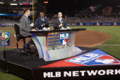 Network analysts Greg Amsinger Harold Reynolds and John Smoltz broadcast their postgame show from ATT Park following the semifinal game between Team...