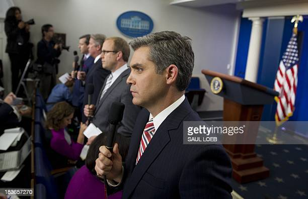 Network and cable news correspondents including CNN's Jim Acosta do standups prior to a press conference by US President Barack Obama in the Brady...