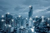 Network business conection system on cityscape background