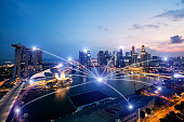 Network business connection system on Singapore smart city scape in background.Network business connection concept