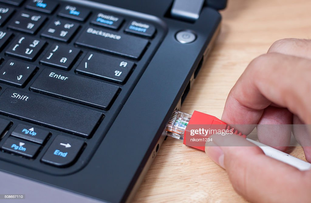 network cables connected to port notebook : Stock Photo
