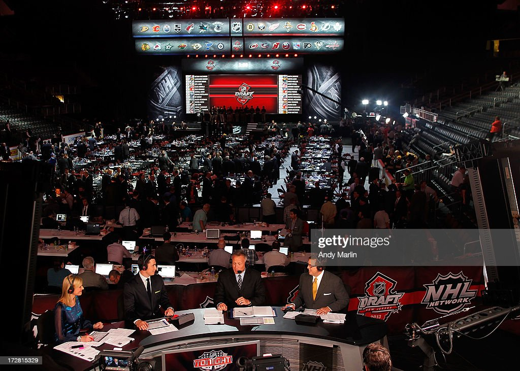 NHL Network host Kathryn Tappan and analysts Mike Johnson, Dave Reid and E.J. Hradek sit on the panel during the 2013 NHL Draft at Prudential Center on June 30, 2013 in Newark, New Jersey.