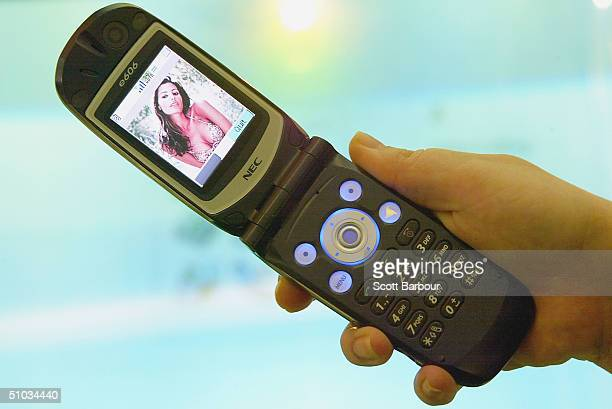 A '3' network mobile phone is held on Oxford Street October 16 2003 in London England The 3 network became available in 60% of the UK during July...