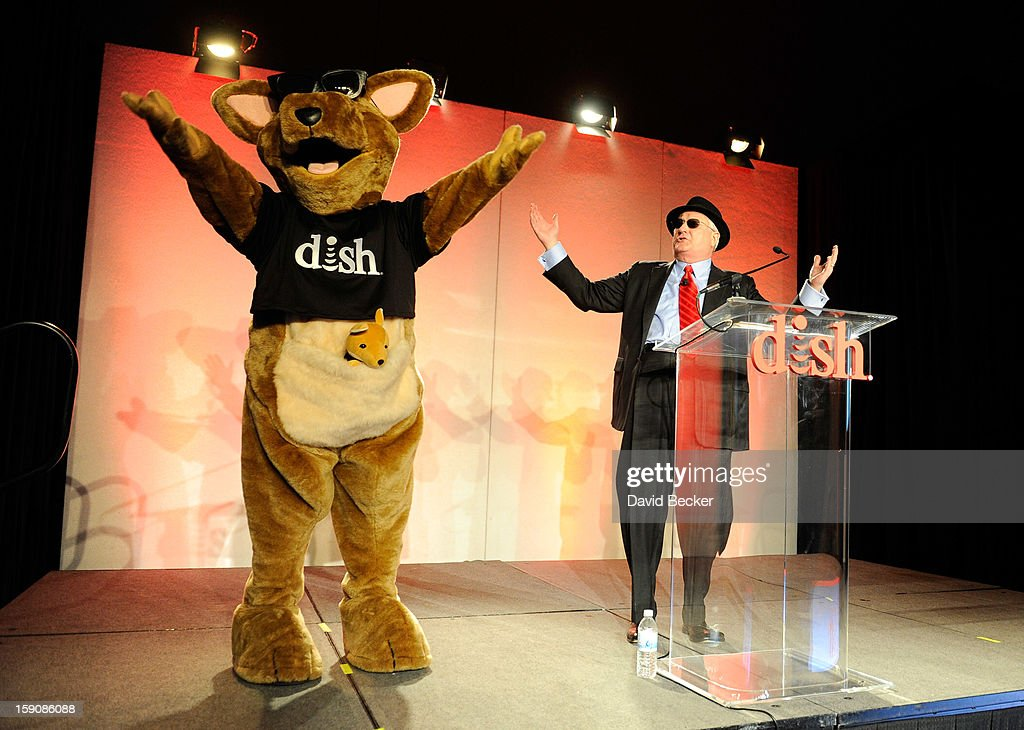 Network President and CEO Joe Clayton (R) and DISH Networks mascot Hopper arrive at a press event at the Mandalay Bay Convention Center for the 2013 International CES on January 7, 2013 in Las Vegas, Nevada. CES, the world's largest annual consumer technology trade show, runs from January 8-11 and is expected to feature 3,100 exhibitors showing off their latest products and services to about 150,000 attendees.