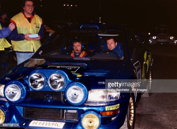 Network Q Rally overnight leader Colin McRae alongside second driver Nicky Grist prepares to leave Cheltenham Race Course early today in his Subaru...