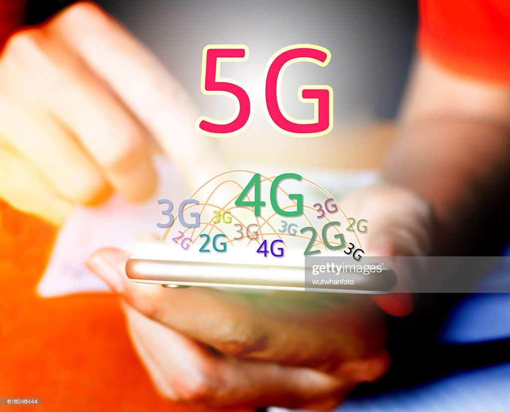 5G networking concept. Businessman using smart phone and touchin : Stock-Foto