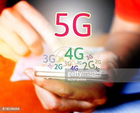 5G networking concept. Businessman using smart phone and touchin : Foto de stock
