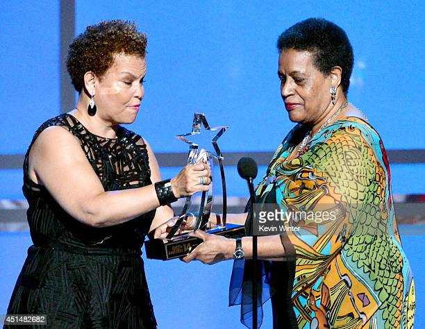 Networks Chairman CEO Debra L Lee presents the BET Humanitarian Award to civil rights activist Myrlie EversWilliams onstage during the BET AWARDS '14...