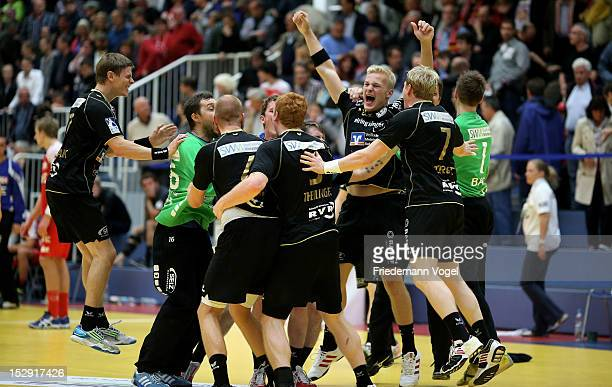 Neuhausen players celebratesafter winning the DKB Handball Bundesliga match between TUSEM Essen and TV 1893 Neuhausen at the Sportpark Am Hallo on...
