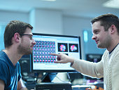 Neuroimaging students in discussion at workstations