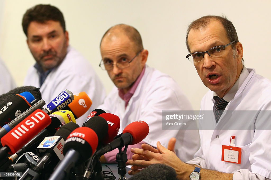 Neurosurgeon Professor Stephan Chabardes, Professor Jean-Francois Payen, and Professor Emmanuel Gay (L-R) attend a press conference at Grenoble University Hospital Centre on Michael Schumacher's medical state following his skiing accident on Sunday in Meribel on December 31, 2013 in Grenoble, France.