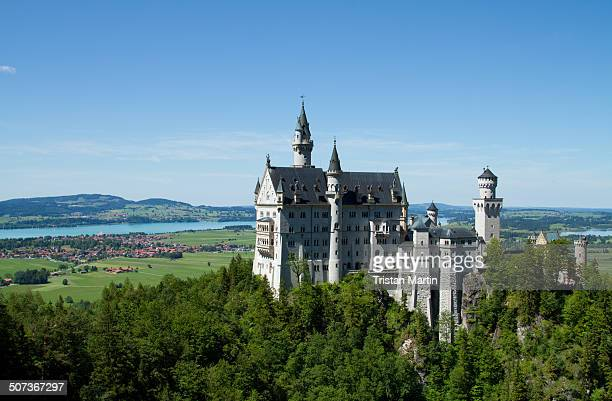 CONTENT] Neuschwanstein Castle which stands above the town of Hohenschwangau in Bavaria Germany on a clear summer day