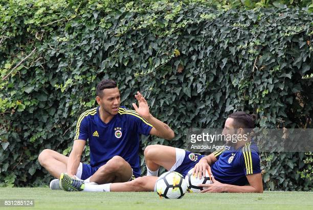 Neustaedter Nabil Dirar and Ismail Koybasi of Fenrebahce attend a training session ahead of the UEFA Europa League First playoff round match between...