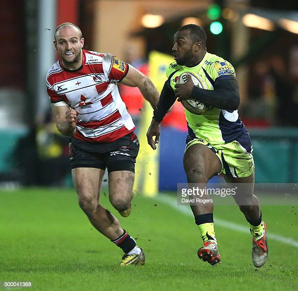 Nev Edwards of Sale races clear of Charlie Sharples during the Aviva Premiership match between Gloucester and Sale Sharks at Kingsholm on December 4...