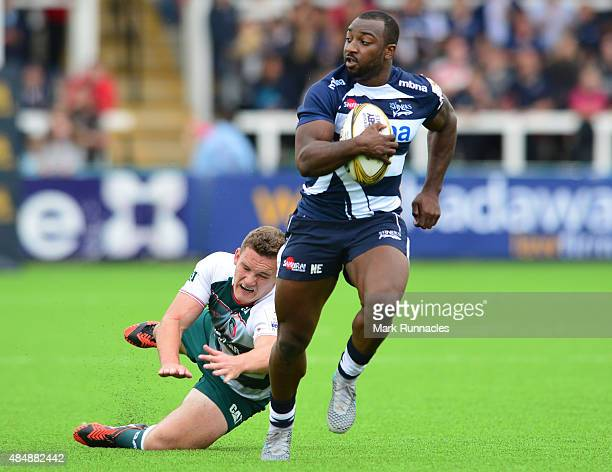 Nev Edwards of Sale Sharks outruns George Worth of Leicester Tigers to score a try during the Singha Premiership Rugby 7s series match between...