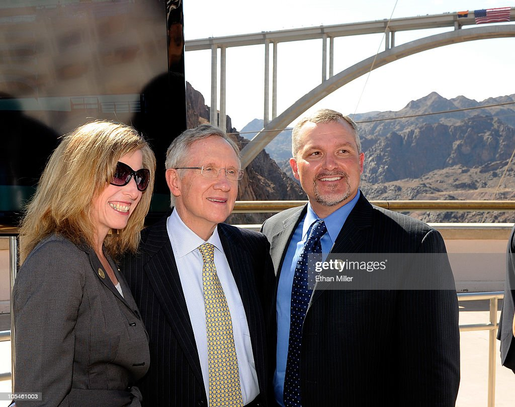 Nevada Department of Transportation Director Susan Martinovich, U.S. Senate Majority Leader Harry Reid (D-NV) and Nevada Department of Transportation Deputy Director Scott Rawlins pose together at the dedication of the Mike O'Callaghan-Pat Tillman Memorial Bridge part of the Hoover Dam Bypass Project October 14, 2010 in the Lake Mead National Recreation Area, Nevada. The 1,900-foot-long structure sits 890 feet above the Colorado River, about a quarter of a mile downstream from the Hoover Dam. The USD 240 million project to relieve vehicle traffic on the Hoover Dam began in 2003, and is scheduled to be open to traffic by next week.