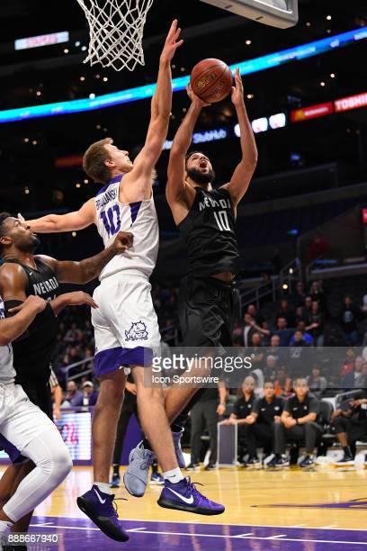Nevada forward Caleb Martin attempts to shoot over TCU forward Vladimir Brodziansky during an college basketball game between the TCU Horned Frogs...