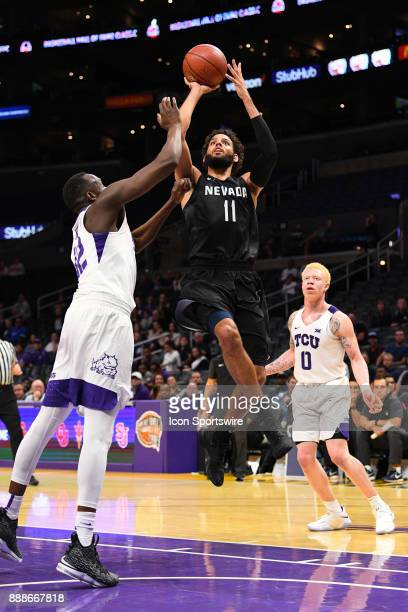 Nevada forward Cody Martin shoots a runner during an college basketball game between the TCU Horned Frogs and the Nevada Wolf Pack in the Basketball...